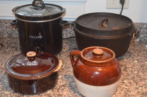Back l-r; CrockPot, cast iron Dutch Oven Front l-r; Ceramic Casserole, Bean pot